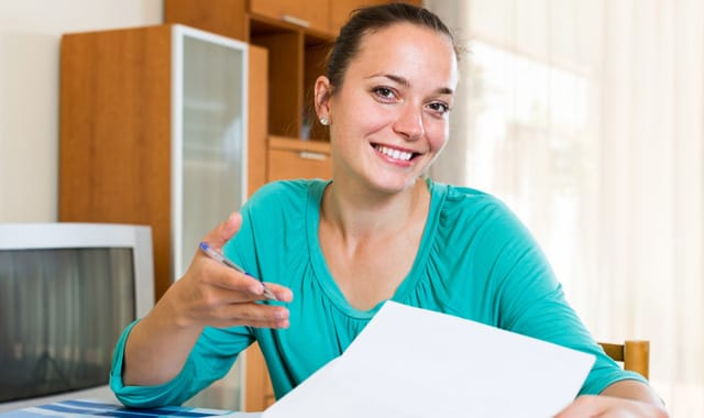 girl working with documents at home