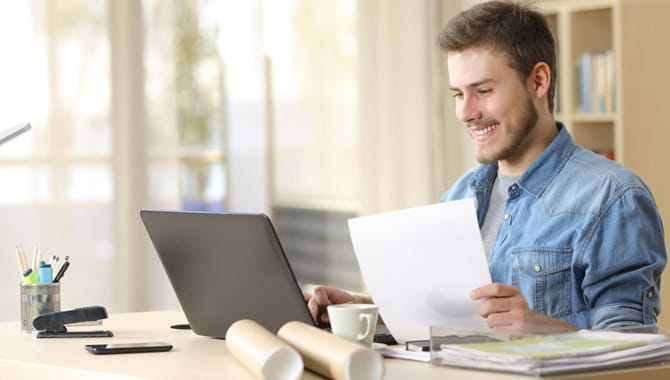 Entrepreneur working with laptop and document