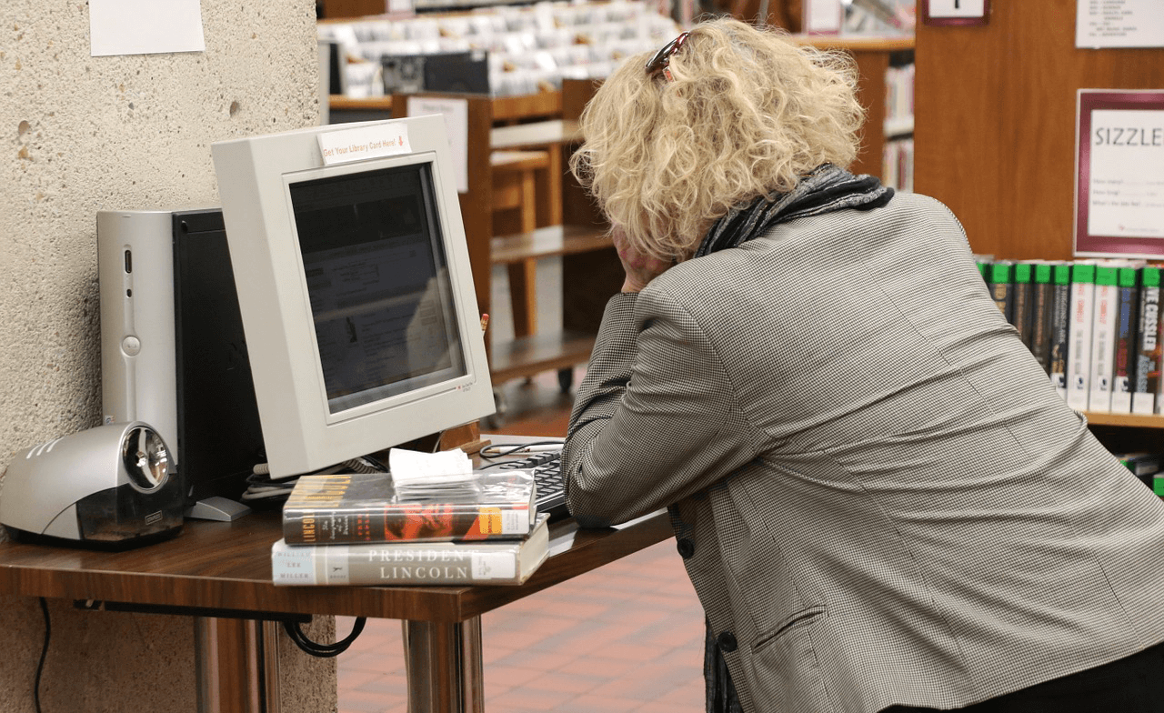 Woman in a library watching