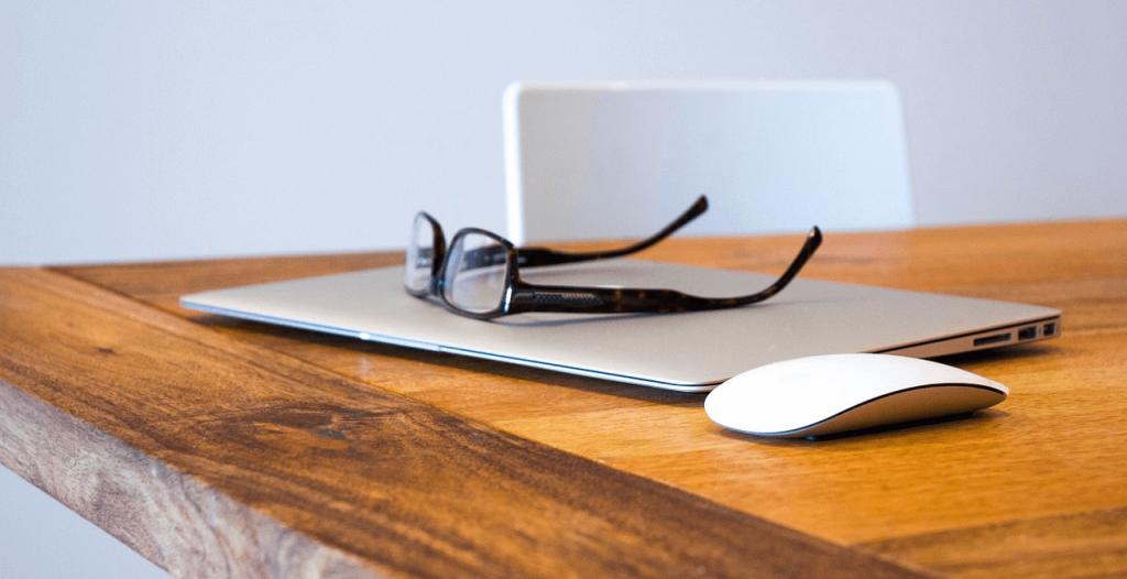 glasses on a mac laptop